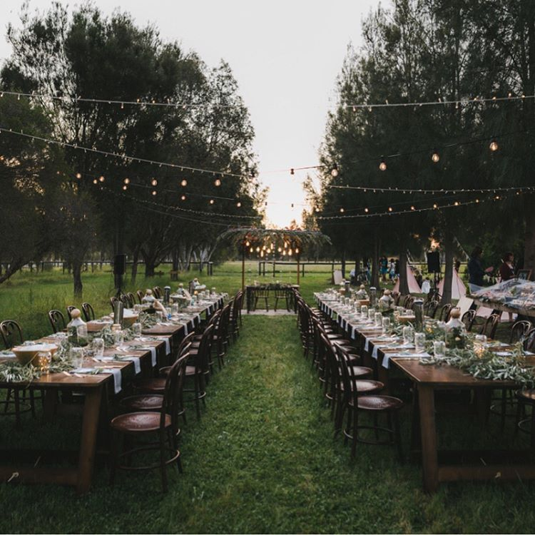 Featured | This stunner of an outdoor love fest featured on the @hellomaymagazine blog this past week, including our banquet trestle tables and dark bentwoods which look especially incredible against this green backdrop. Dreamy images by @amandakalessi, greens by @_thebotanicalhome