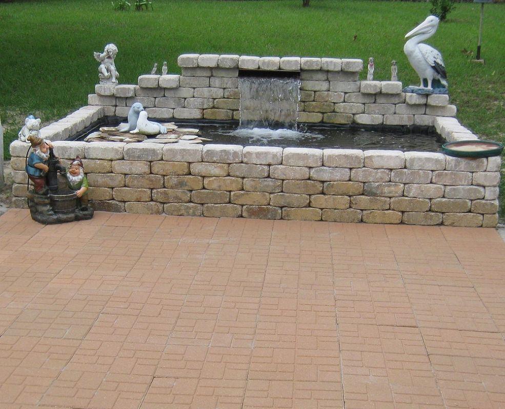Raised formal koi pond and patio pinterest koi pond for Raised fish pond ideas