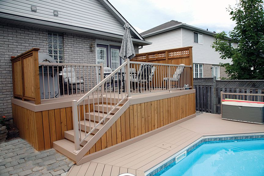 This low maintenance deck has cedar skirt and privacy ...