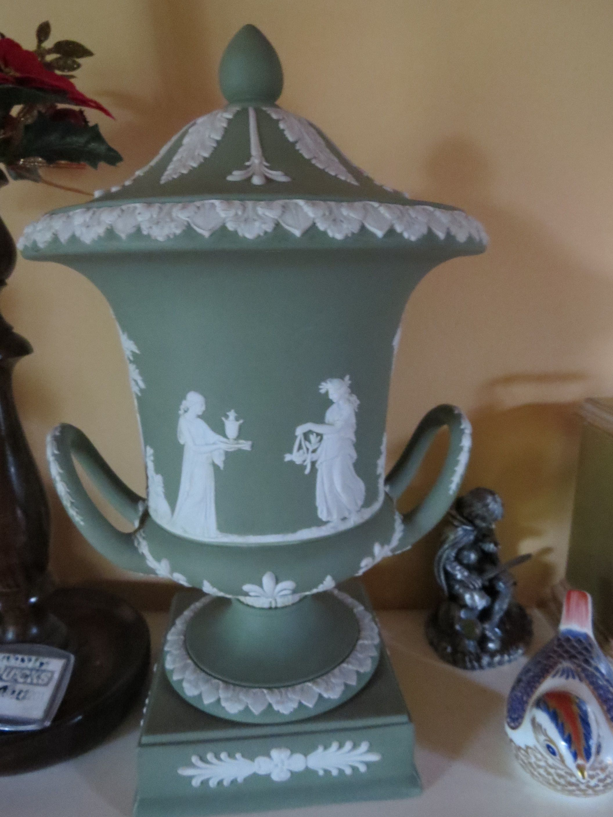 Large green urn, dated 1963.