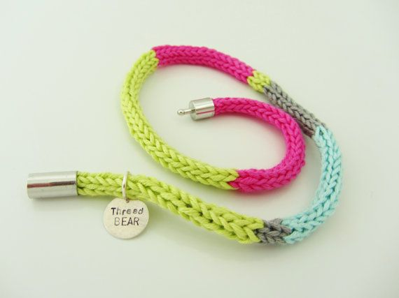 Knitted bracelet in bright colours