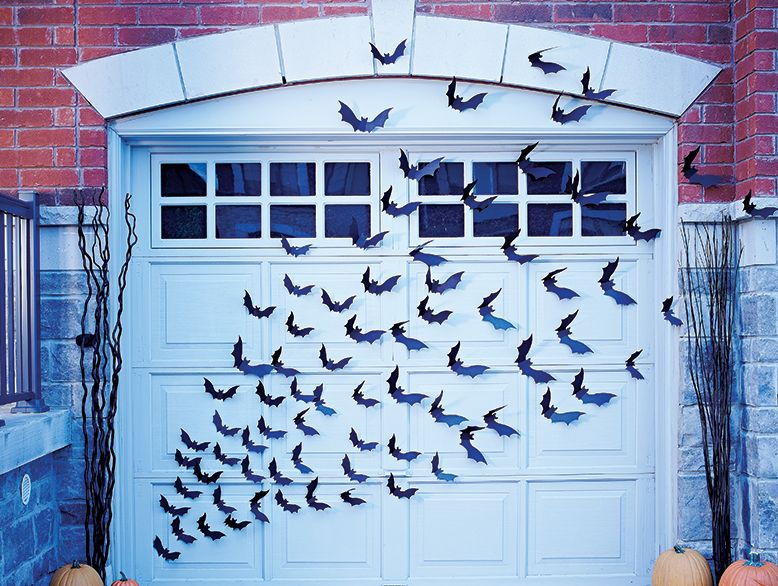 an easy diy halloween decoration for your garage door not really on the spooky side of things but a super neat idea - Halloween Decorations Bats