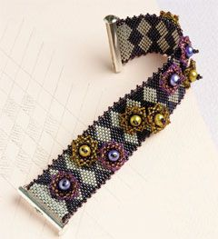 Harlequin Cuff by Laura McCabe. A more modern version of beaded flowers combined with a bold harlequin diamond pattern beaded bracelet. Beaded bracelet pattern available for instant download from the Beading Daily Shop.