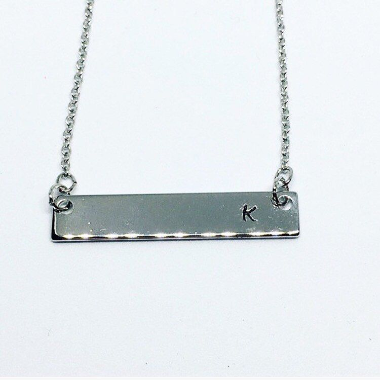 Now you can have your very own name bar necklace in any flavor you desire, white gold, yellow gold or rose gold!!! These 16k plated name bar necklace are personalized any way you would like, with an initial, a name or short saying. 15/16 letters/space can be stamped on one bar. I custom make each o
