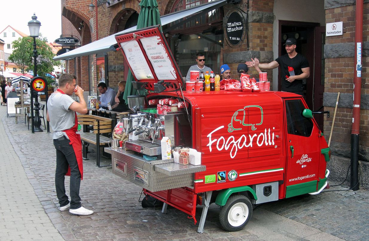 A Barista with his mobile espresso bar in Ystad, Sweden