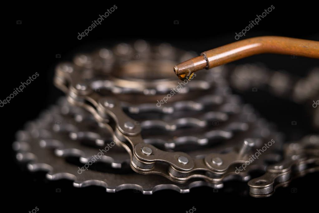 Oiling The Bicycle Chain With An Oil Can On The Workshop Table Stock P Aff Chain Bicycle Oiling Oil Bicycle Chains Bicycle Bicycle Diy