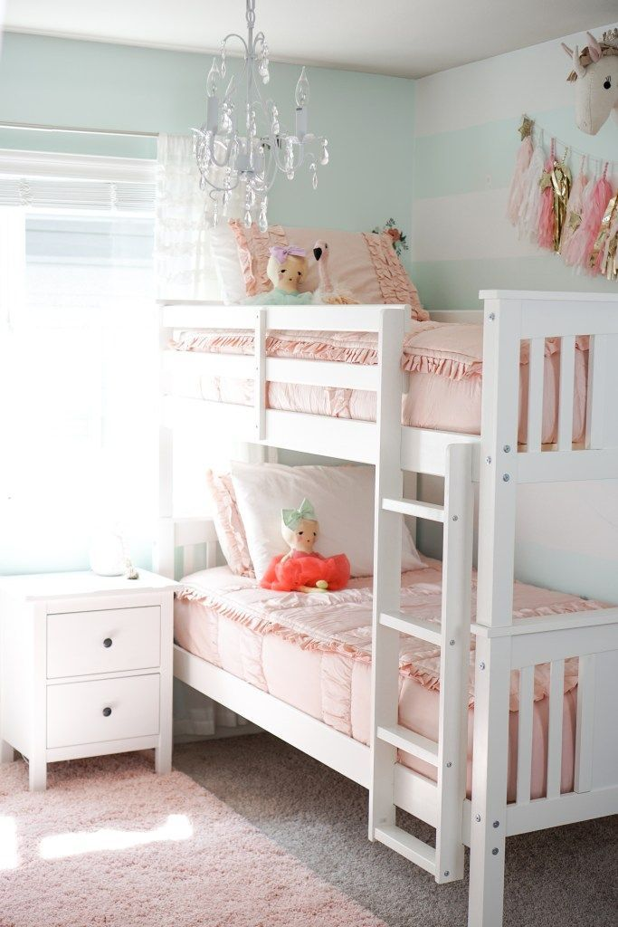 Big Girl Bedroom Update - The House of Hood Blog #beddysbedding Our big girls bedroom update! Complete with bunk beds and new pink bedding by Beddy's Beds. Pink accents, tassels, aqua stripes, and a chandelier. Super simple changes make a huge transformation! #childrensdecor #kidsbedroom #girlsbedroom #tassels #unicorns #chandelier #shabbychic #goldaccents #bedroomdecor