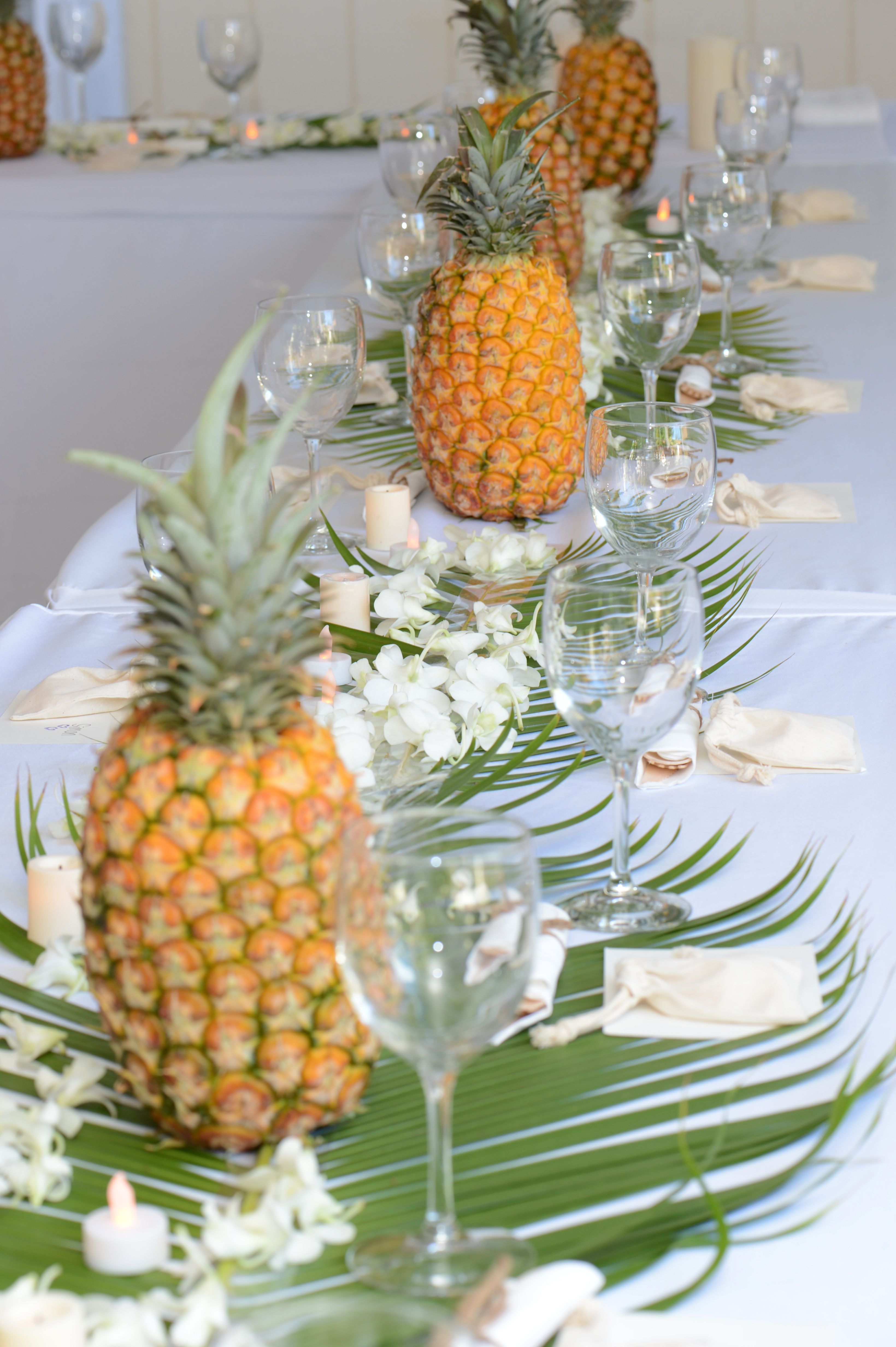 hawaii pineapples as table decor i would need to add flows though