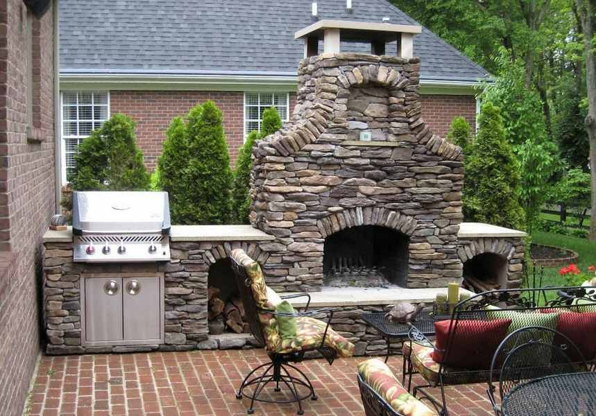 Medieval design idea for carelessly stacked stone patio fireplace ...