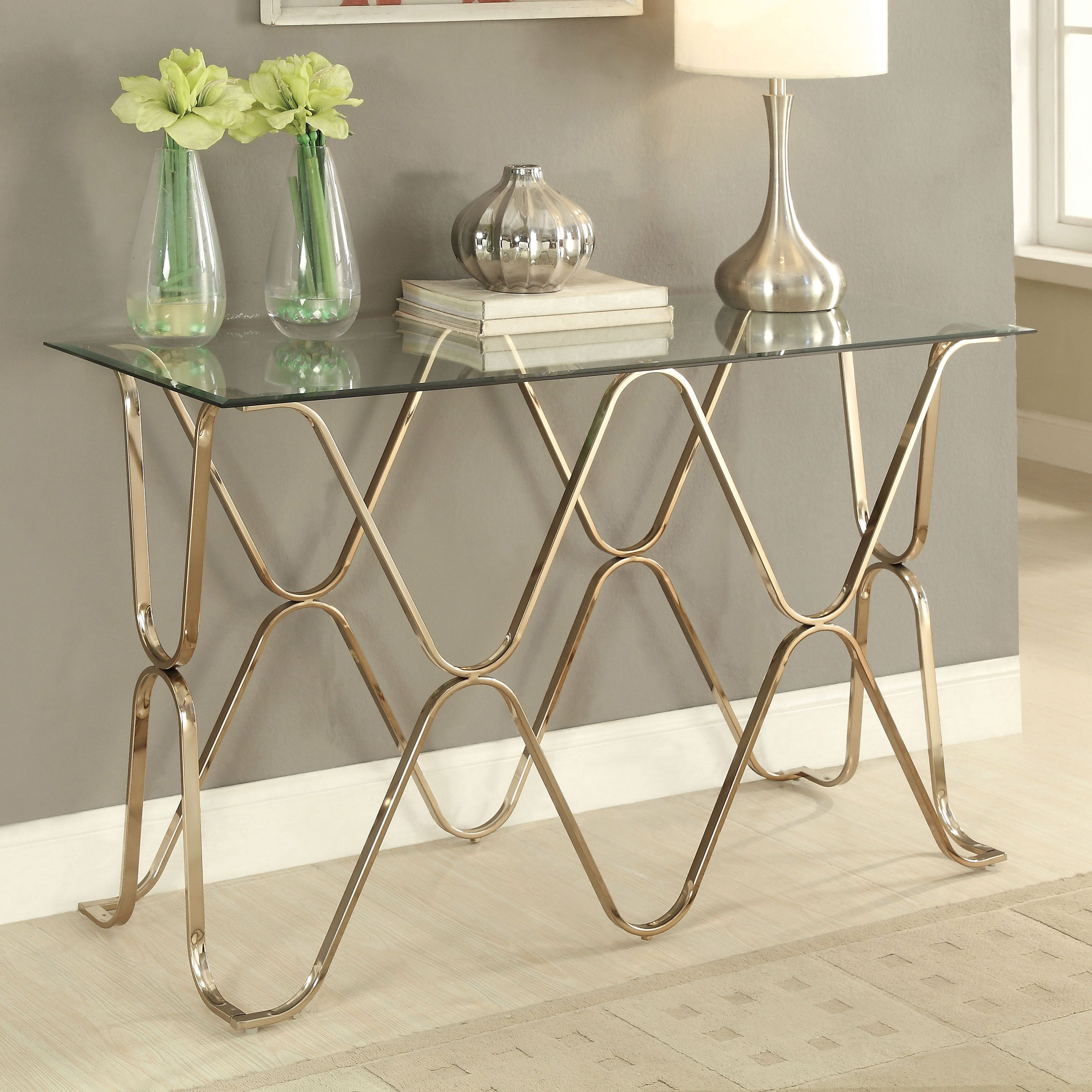 Furniture of america tellarie contemporary champagne sofa table by charming curves come together to provide a unique and shined base for this contemporary sofa table geotapseo Choice Image