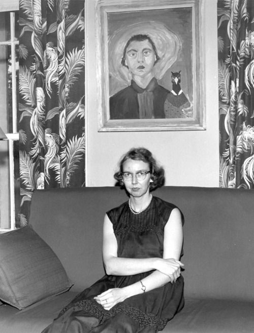 "Flannery O'Connor, Southern writer (of the novel Wise Blood and short stories) - in 1964, aged 39, from lupus…  ""Whenever I'm asked why Southern writers particularly have a penchant for writing about freaks, I say it is because we are still able to recognize one."" — F. O'C.  Photo of Flannery in front of her self-portrait w. peacock…"