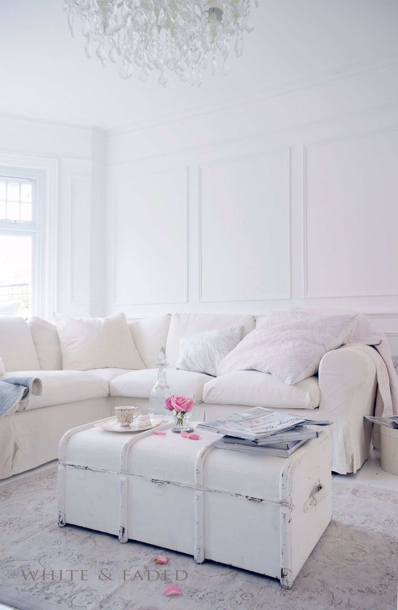White living room with pastels