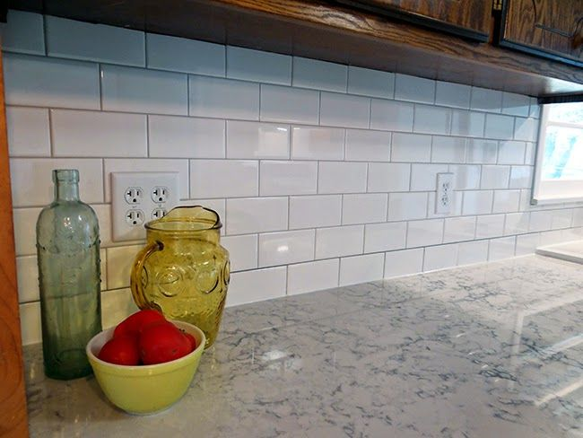 carrara marble backsplash with gray grout helix silestone counter white subway tile dove gray grout