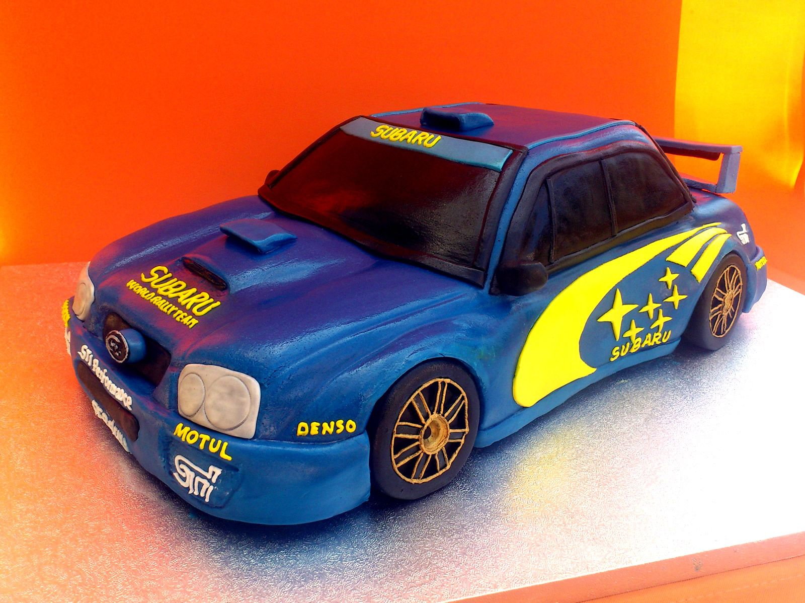 Blue and Yellow Subaru Rally Car Novelty Cake Susies Cakes