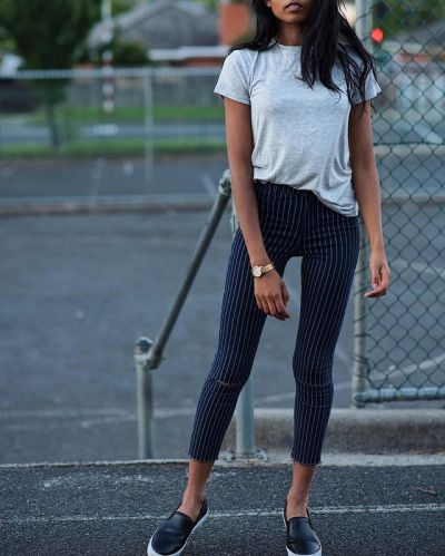 For a fashionable alternative to jeans, wear pinstriped trousers like these, paired here with a simple grey tee and patent leather Adidas flats. Via Pose & Repeat.  Tee: Zara, Shoes: Adidas Originals. Spring.