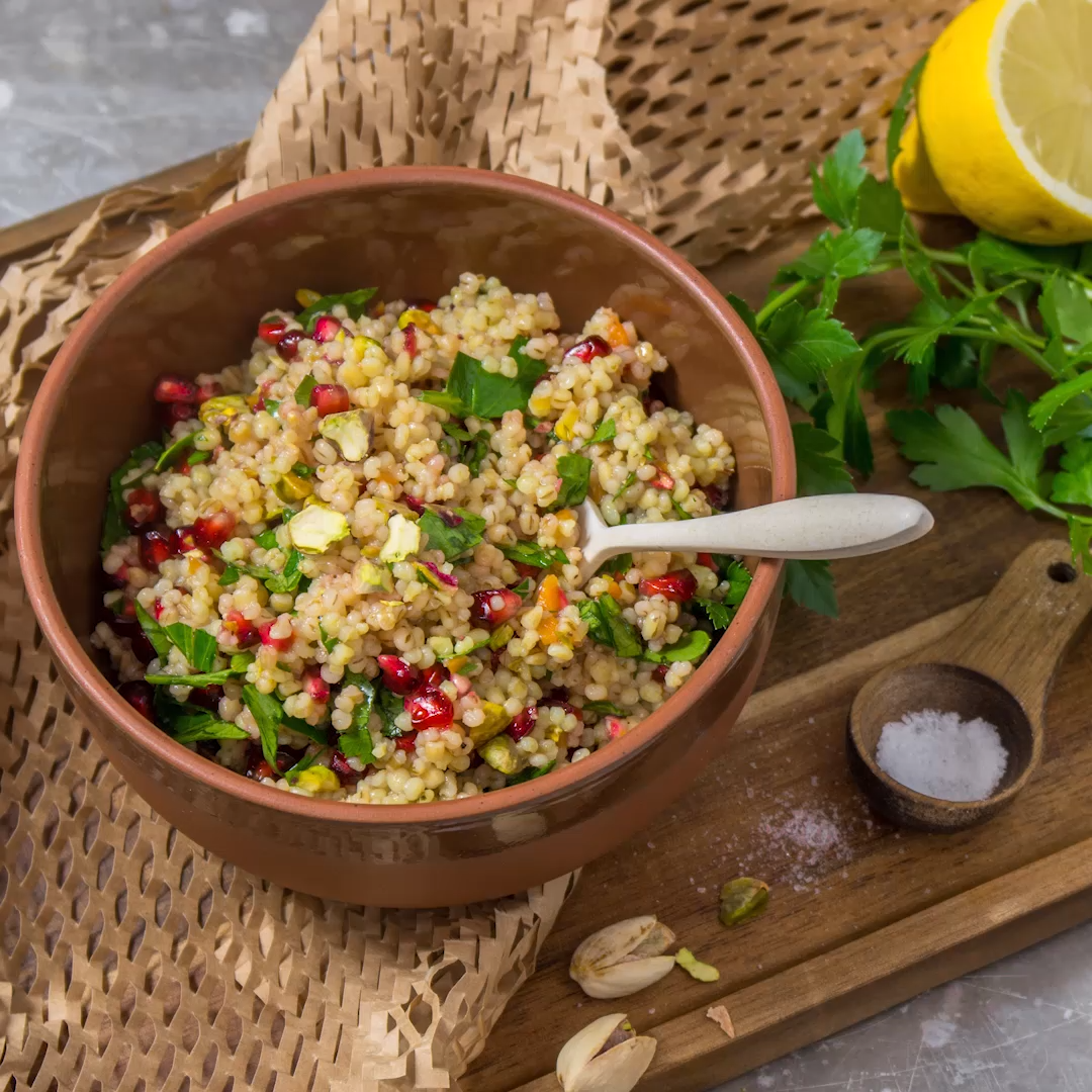 Photo of Healthy lunch: barley salad with pomegranate