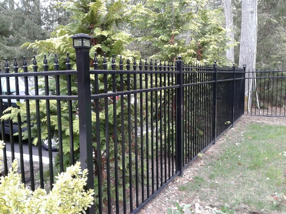 Ornamental Aluminum Fence With Solar Lights Installed In Syosset