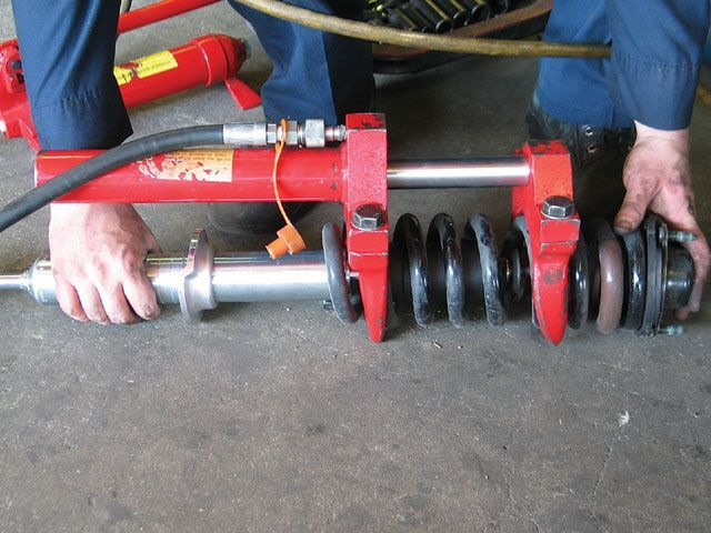Hydraulic coil spring compressor.  Yeah baby!!