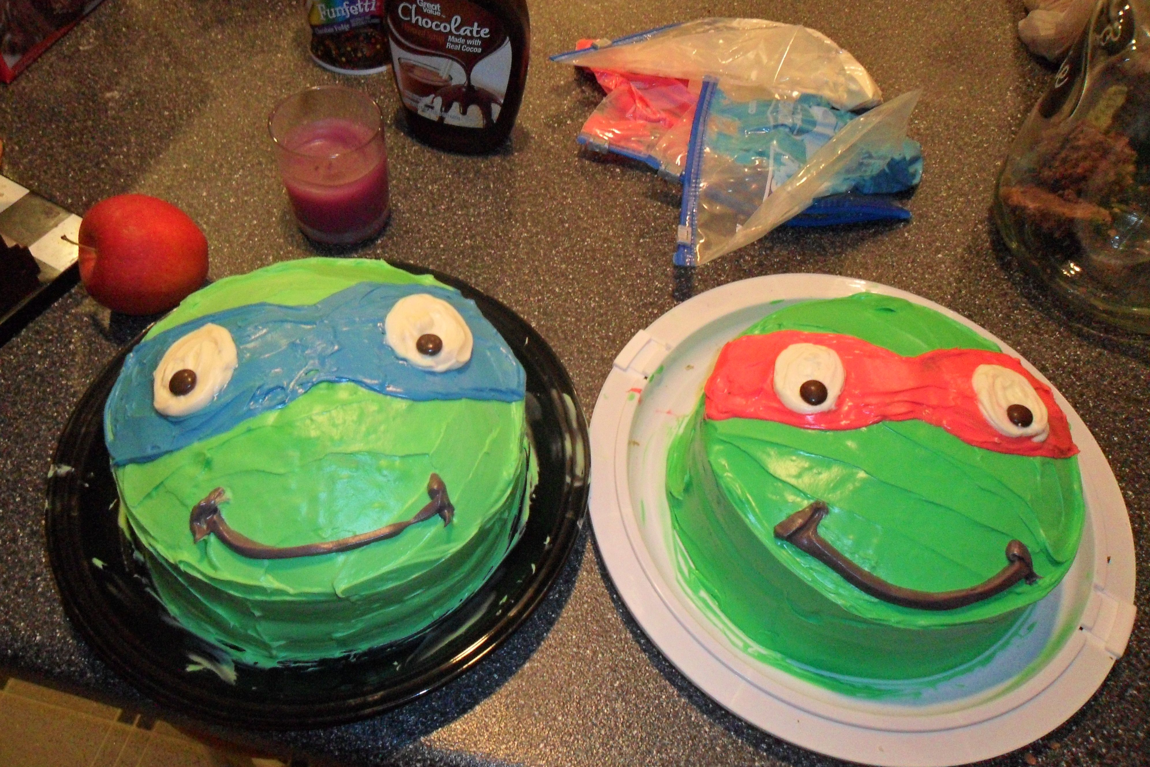 Teenage mutant ninja turtle cakes I made. very simple and used ziplock bags with the corner clipped to decorate.. and m&m's for part of the eye