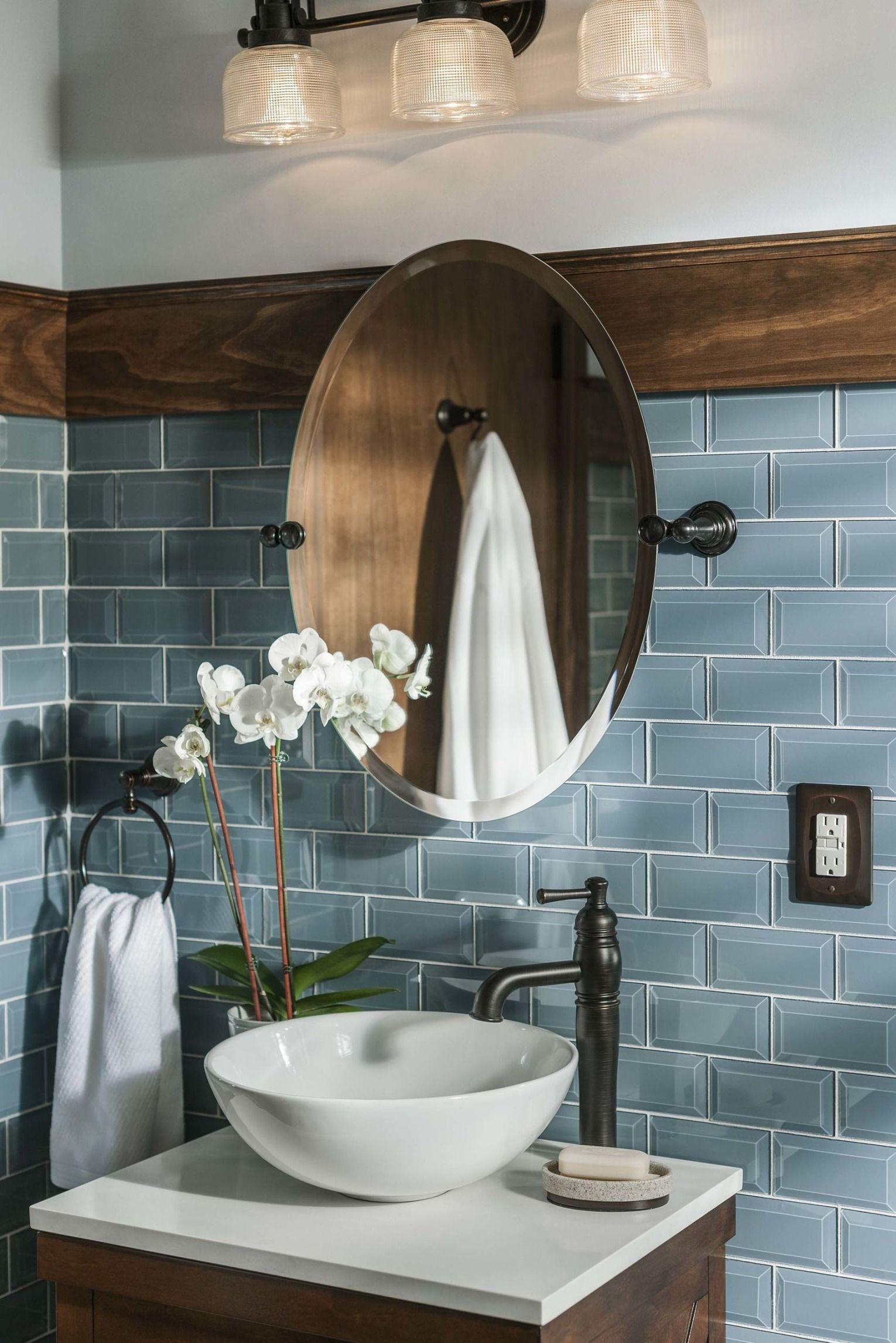 The right light fixture makes the vanity and bathroom shine in more