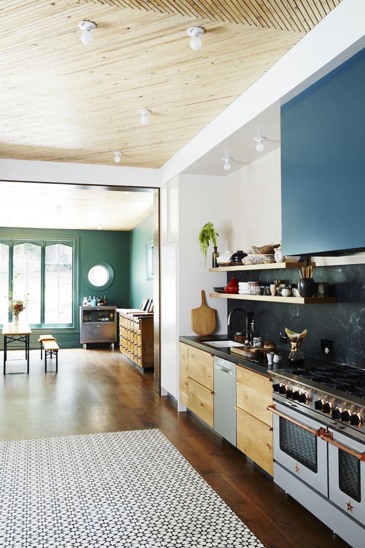 Open floor plan kitchen with black marble back splash open shelving