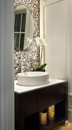 tile backsplash behind your mirror in a small bathroom