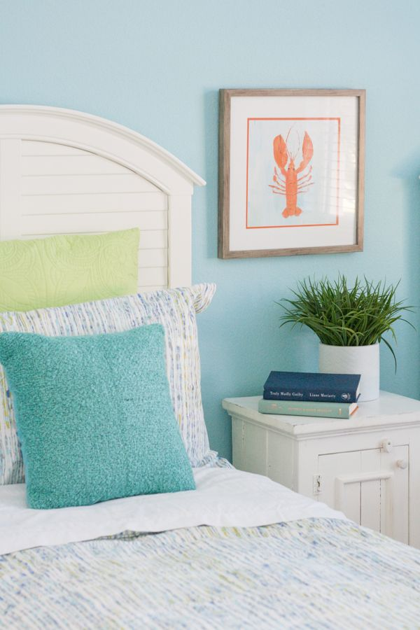 coastal kids guest room bright bedding teal walls and