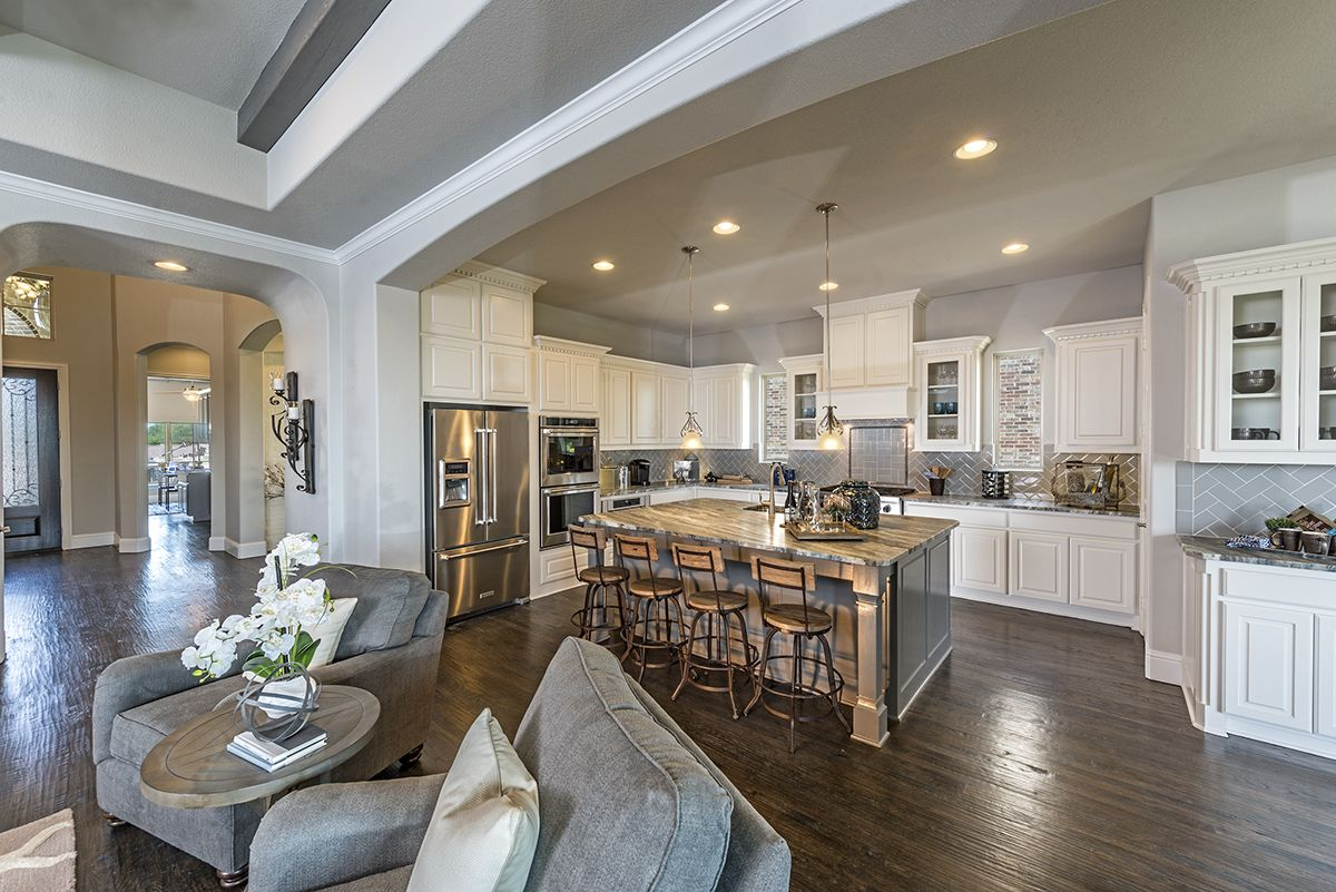An Upgraded Kitchen With Space For Everyone To Gathering And An Abudance Of White Cabinets For You Favorite Dishes Enjoy Delicio New Homes Kitchen Models Home