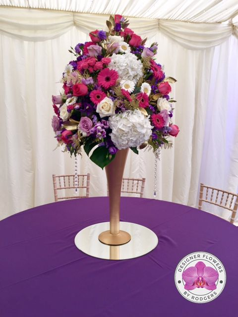 Amazing Table Centre Pieces   Designed On Tall Gold Trumpet Vases Sat On Mirrors.  White Avalanche Roses, Deep Purple And Lilac Lisianthus, White And Purple  ...