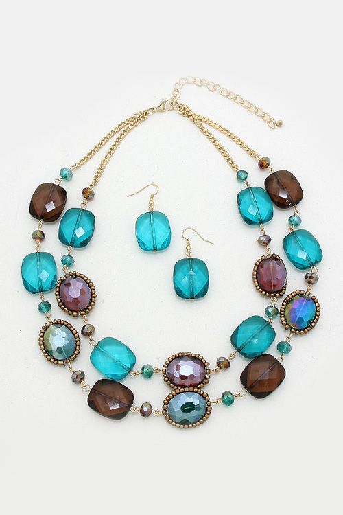 Chic, versatile set, outlined with bronzed seed beads, topaz and teal crystals.