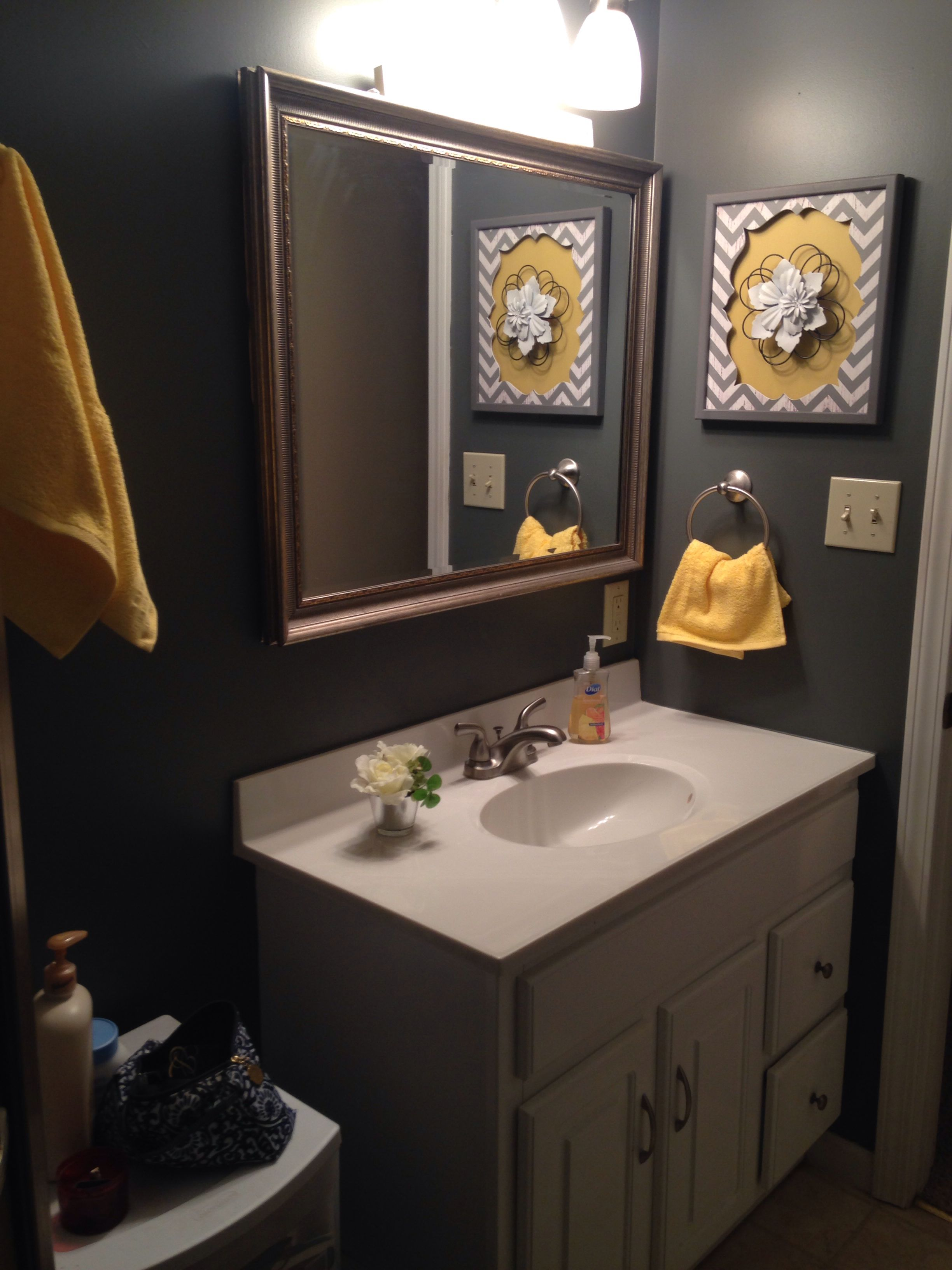 grey and yellow bathroom needs a pretty floral shower curtain and a pop of color