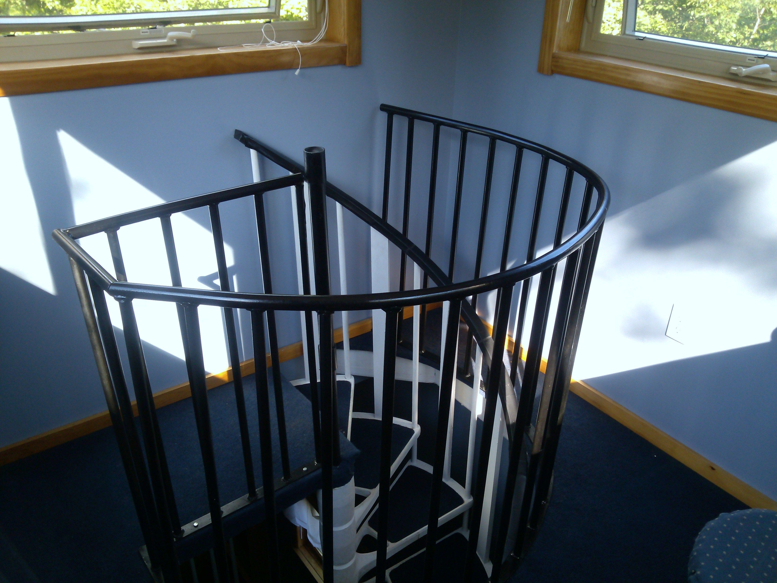 Top safety rail spiral stairs in tower room spiral