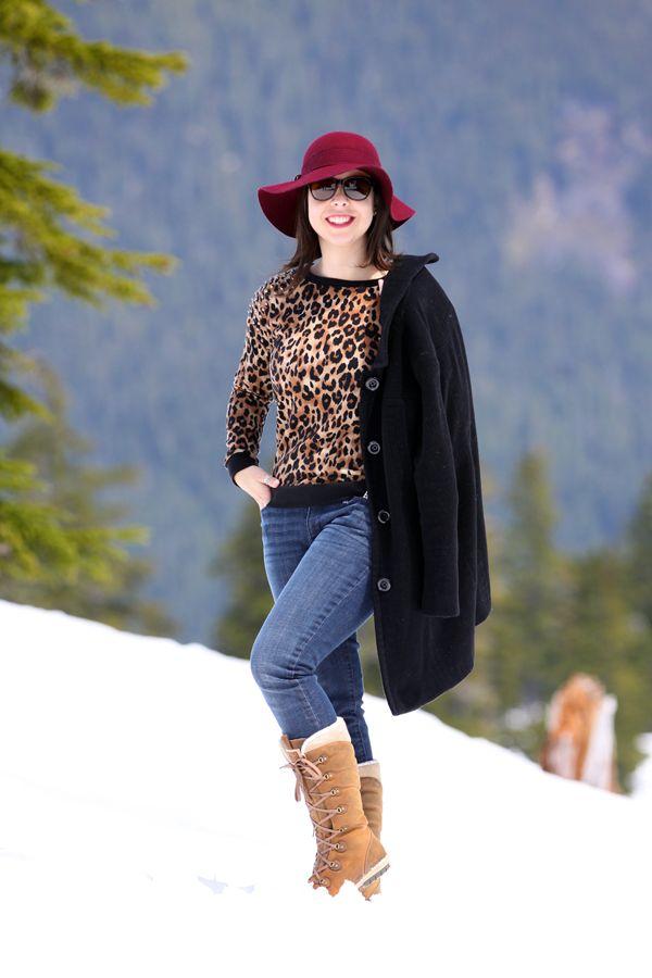 Neve: moletom de onça + casaco preto + chapéu