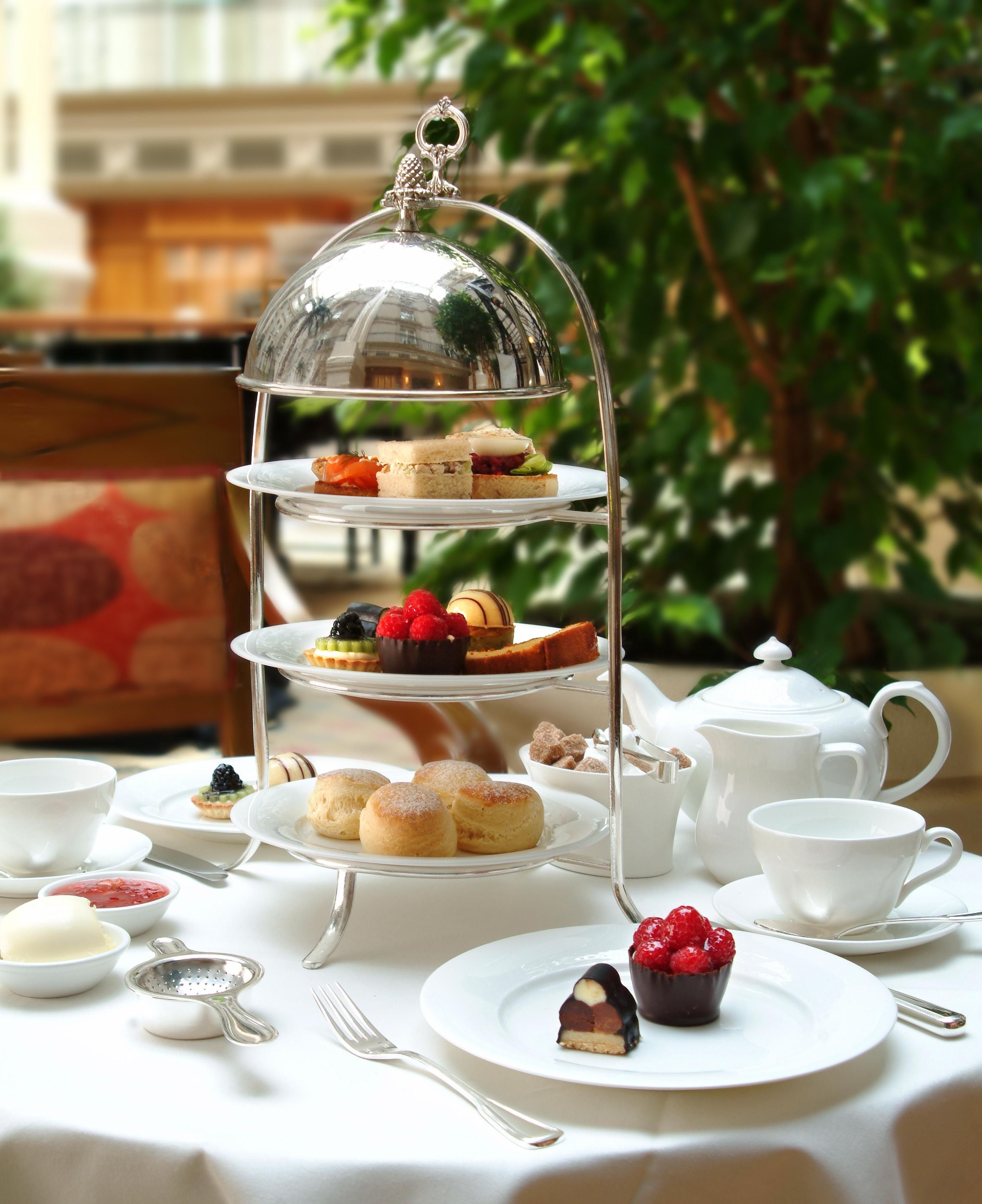 afternoon tea in the winter garden at the 5 star landmark london