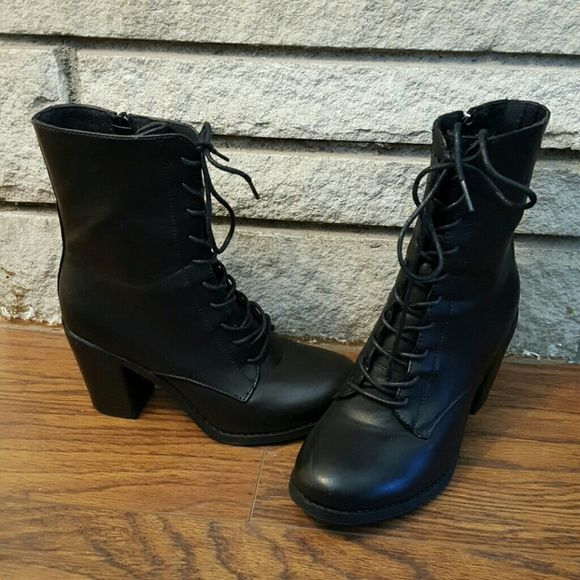 Black Combat Boots with High Heel Black combat boots with thick, 3in heel that provides support and gives shape to legs. Laces in front and zipper for snug fit. Great boots worn only once! Rouge Shoes Combat & Moto Boots