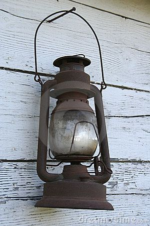 Old Rusted Antique Lantern Hanging On Barn Wood Old West