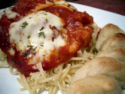 I found this recipe a few years back for a home made chicken parmesean whit a semi-homemade marinara sauce. I use the sauce for anything that calls for a marinara, it's simple, inexpensive and delicious. I've never atempted the bread stick befor tho.     http://www.themotherhuddle.com/chicken-parmesan/