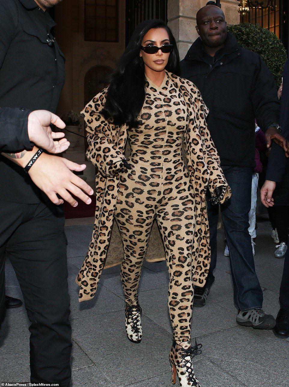 ddc4d1bbf9d3 Kim Kardashian makes a bold statement in  10k leopard print outfit ...