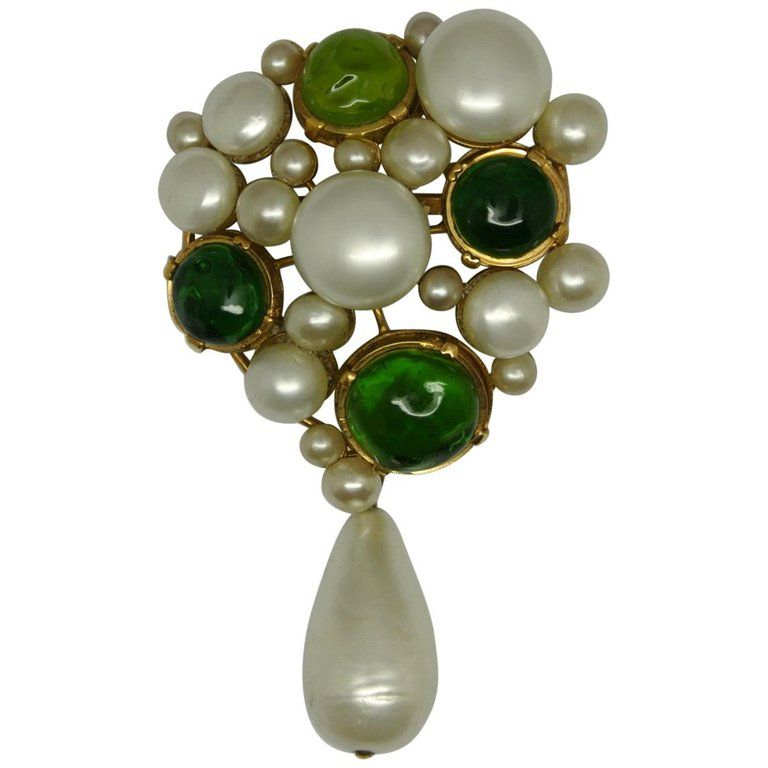 e15fcfa6f For Sale on 1stdibs - A Chanel signed brooch, dated 1970s. comes with green glasses  and faux irregular pearls, specially made by Gripoix workshop.