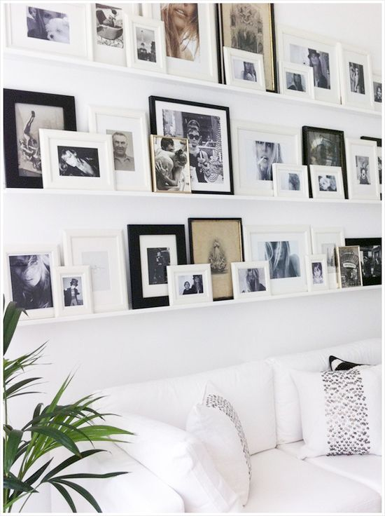 awesome feature wall, family photos, frame placement, frames. white ...