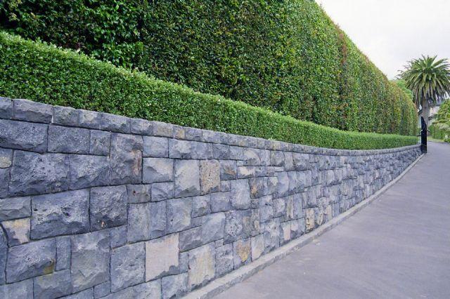 Honeycomb Basalt Retaining Wall With Kerbstone Capping Stone Wall Design Retaining Wall Garden Retaining Wall