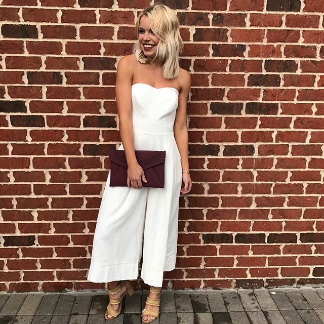 Go white hot and fashion forward this summer in this strapless, wide-leg jumpsuit from Greylin! Shop online, in store, or call to order! #shopatl #atlantaboutique #shopsmall #shoplocal #stayHIP #handinpocket #springtrends #ootd #outfitinspiration #widelegjumpsuit #straplessjumpsuit #trendy #whitehot #greylin