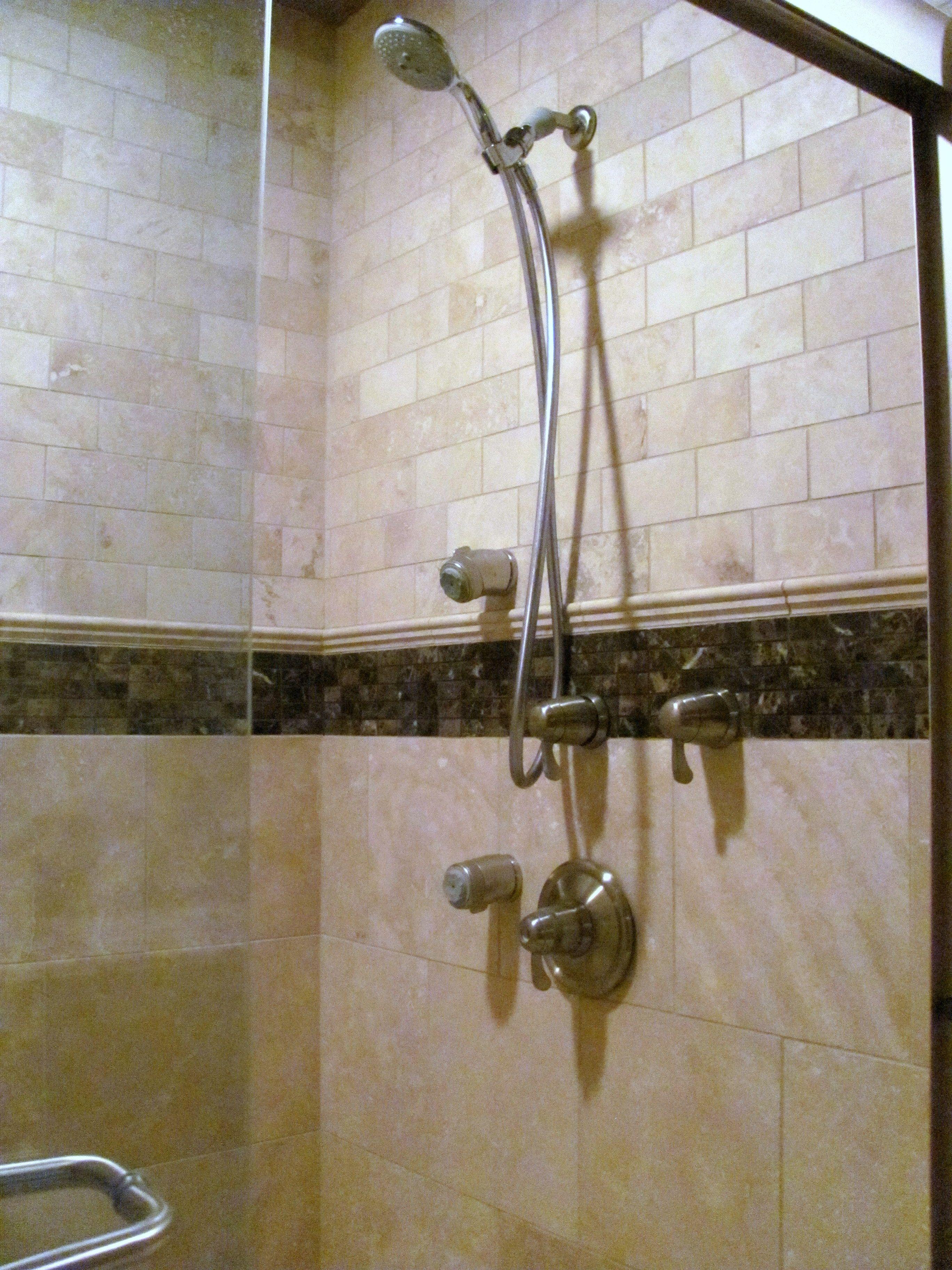Custom travertine shower with dark emperador marble trim. Multi-head ...