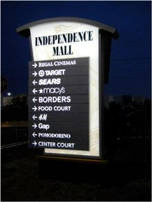 Independence Mall Solar Sign  Erected in locations not easily accessed by electrical power sources, these ARTfx designed and engineered solar-powered signs direct shoppers to stores around the Independence Mall in Kingston, MA.