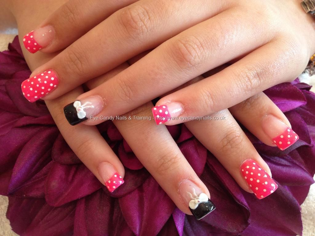 Acrylic nails with pocker dot as nail art and 3D bows on ring finger ...
