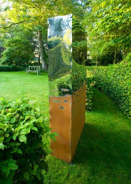 peaceful garden sculpture and mbench Metal outdoor art - the Titan