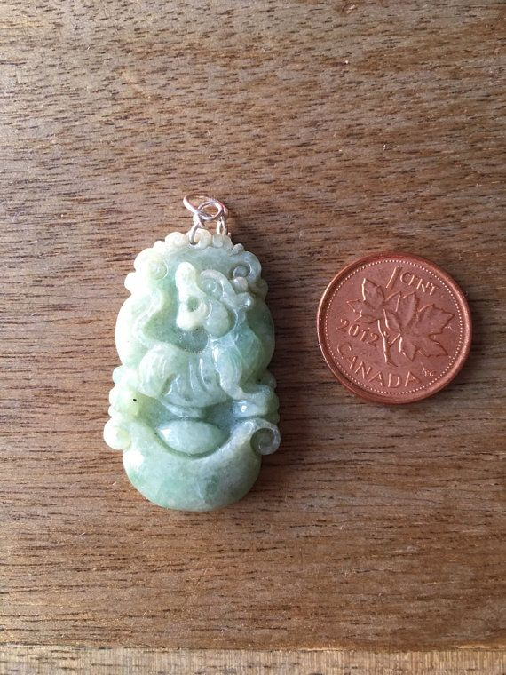 This pendant is for the jade lovers out there! Intricately engraved in jade, this one is sure to turn some heads!  - made with light green jade