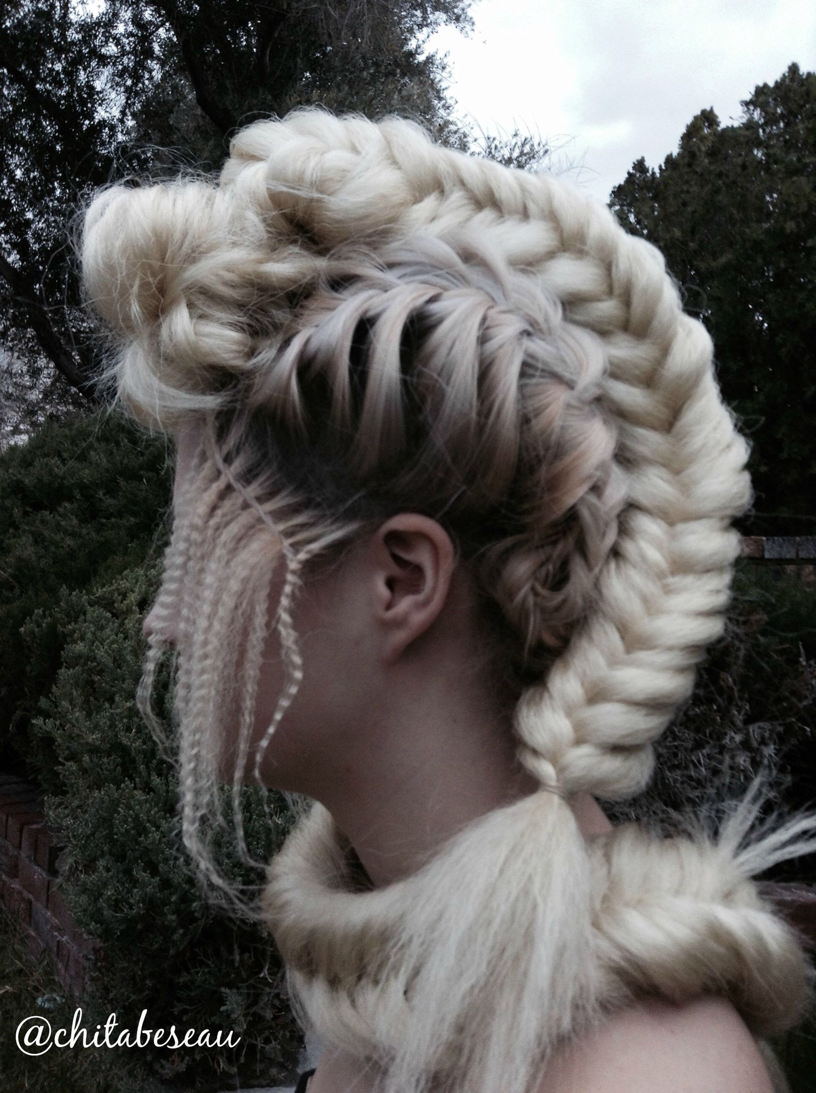 Platinum blonde hair wrapped into an intricate braid design by chita