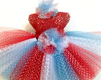 Red, white, & blue tulle accented with glitter star tulle makes this a perfect tutu for the 4th of July. coordinating glitter tulle added for extra sparkle. size: Medium waist is 18 length is 10. Matching hair accessory included. *Fabric on top hat may vary from photo. Sizing: 13-14 waist Extra Small/Infant 15-16 waist Small 6 months to 2T 17-18 waist Med. 2T to 4T 19-21 waist Large 5, 6, 7