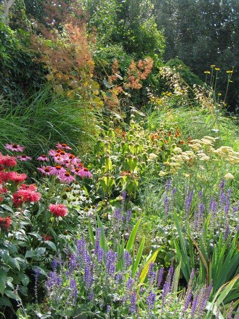 A Wimbledon Garden By Wilson McWilliam Studio. The
